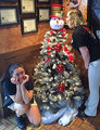 Team members Heather Kelso and Darien Maness have a little fun with the Snowman Tree!