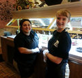 New employee, Bianca Workman, training with Maria Speed on the salad bar